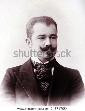 RUSSIAN EMPIRE - CIRCA 1917: Vintage photo of a young nobleman with a mustache - stock photo