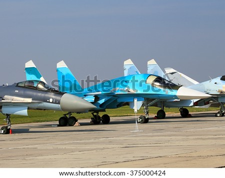 Russian fighter jets parked at a military airbase - stock photo