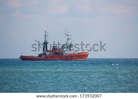 Russian fishing boat floats in the open sea, outdoors shot,