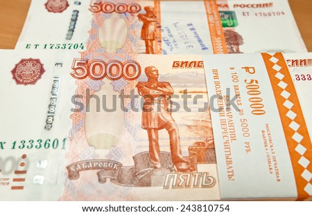 Russian five thousand rubles banknotes at the wood background. - stock photo