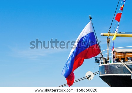 Russian flag flies at the stern old sailboat - stock photo