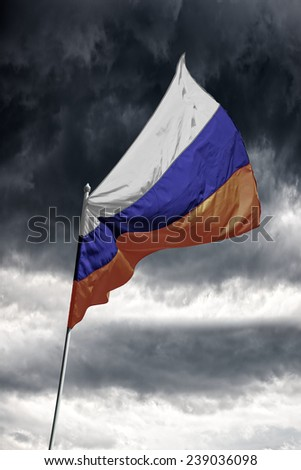 Russian flag on a dark cloudy dramatic sky.  - stock photo