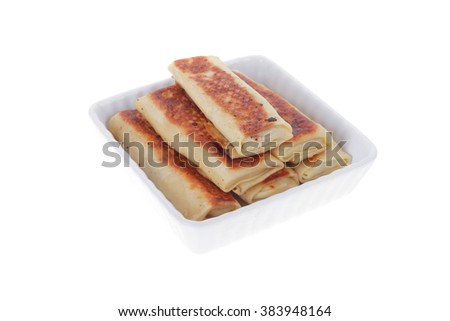 russian food - pancake with various fillings served in white bowl isolated over white background - stock photo