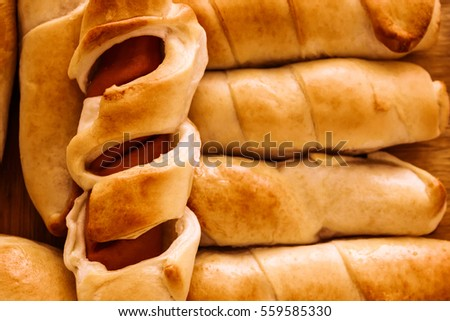 Russian fried sausage in dough in oven