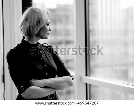 Russian Girl standing at the window in the office