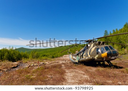 Russian helicopter under the blue sky in mountain