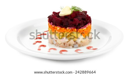 Russian herring salad on plate isolated on white - stock photo