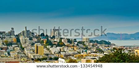Russian hill and Golden Gate bridge seen from Telegraph hill, San Francisco, California, USA - stock photo