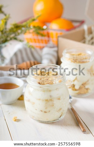 Russian honey cake in a glass jar - stock photo