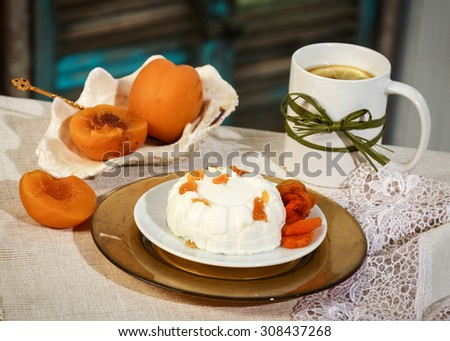 Russian kitchen. Country cheese pudding with peaches and dried apricots. Tea with lemon. Vintage utensils.