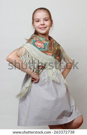 Russian little girl in traditional Pavloposadskij scarf dancing - stock photo