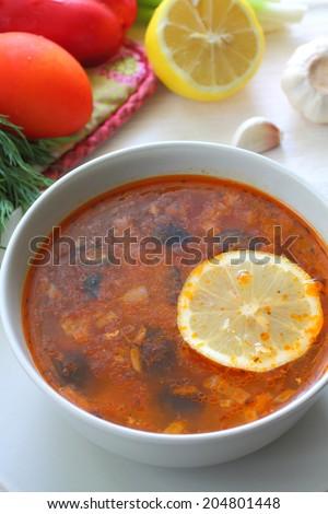 Russian meat soup - Solyanka  - stock photo