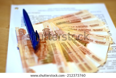 Russian money and the contract - stock photo