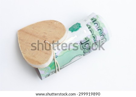 russian money and wooden heart symbol - stock photo