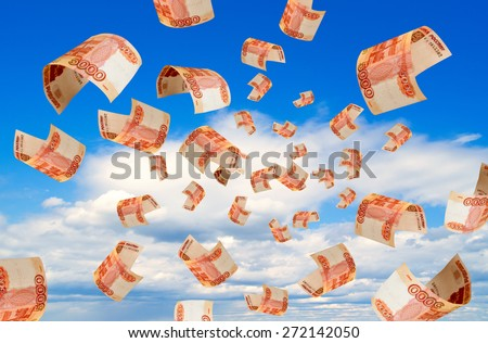 Russian money falling from the sky. - stock photo