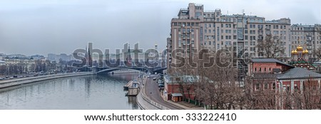Russian Moscow Kremlin and the Variety Theatre, bridge and Moscow river. Moscow river embankment. - stock photo