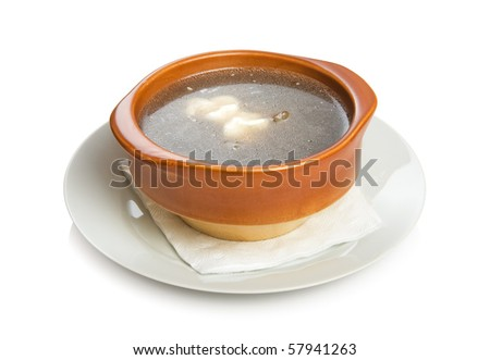 Russian mushroom soup with sour cream. Isolated on white by clipping path.