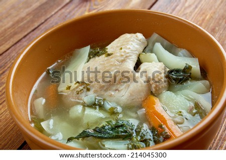 Russian national cabbage soup - Green sorrel stchi with nettles and rhubarb - stock photo