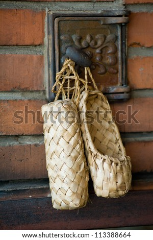 Russian national footwear, bast shoes - stock photo