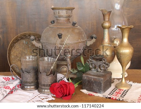 russian old samovar, teapot, cup and beautiful and rose