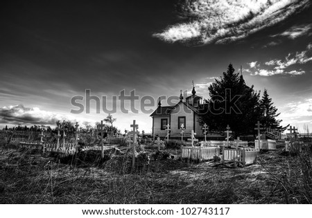 Russian Orthodox church and cemetery in Nikiski Alaska in black and white.