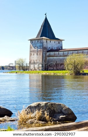 Russian orthodox monastery castle tower on the lake shore in Kirillov. Vertical image