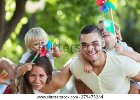 Russian parents walking with children on vacation day at park  - stock photo
