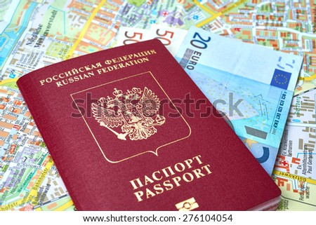 Russian passport and Euro banknotes on the map background - stock photo