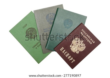 Russian passport, certificate of secondary education, employment history and birth certificate isolated over white