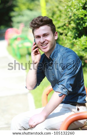 Russian red hair man in park with telephone