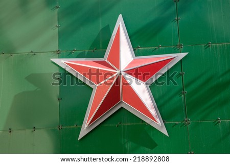 russian red star on green metallic background - stock photo