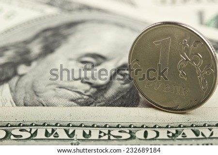 Russian ruble against the background of dollars - stock photo