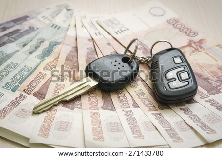 Russian Ruble and car keys on the table - stock photo
