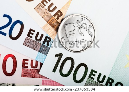 russian ruble coin on the European banknotes  - stock photo