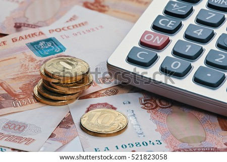 Russian ruble currency, money with calculator close up