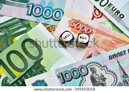 Russian Ruble, Euro banknotes and dices cubes - stock photo