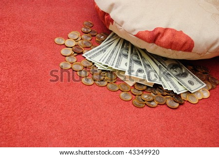 russian rubles and american dollars are stored under pillow - stock photo
