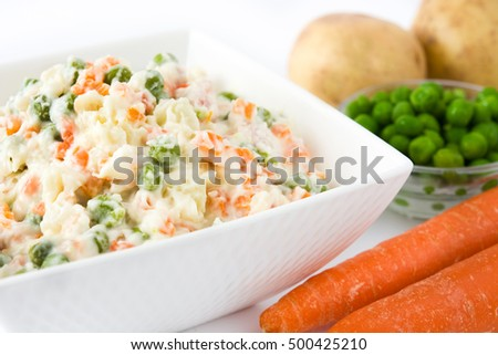 Russian salad and ingredients isolated on white background