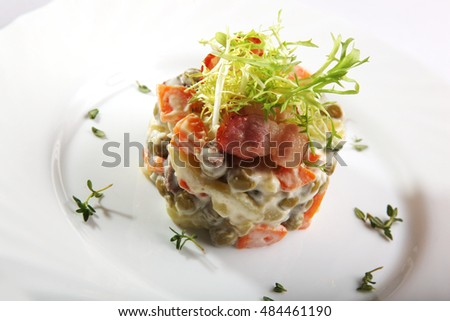 Russian salad with Bacon on plate