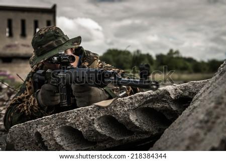 Russian sniper hidden behind concrete block - stock photo