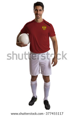 Russian soccer player holding ball on white background