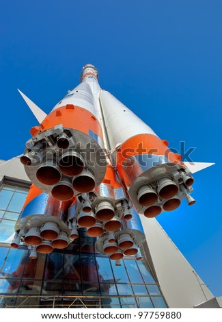 Russian space transport rocket over blue sky background - stock photo