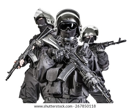 Russian special forces operators in black uniform and bulletproof helmets - stock photo