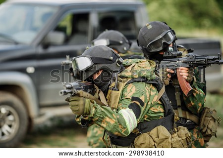 Russian special forces operators in uniform and bulletproof vest and helmets - stock photo