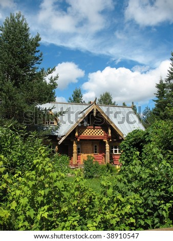 Russian style. Wooden blockhouse on the blue sky background.