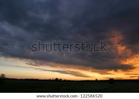 Russian summer field at sunset