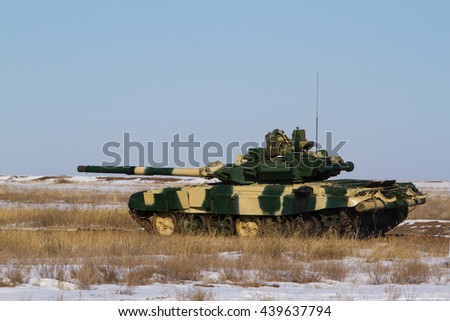 Russian tank at the landfill. Side view.