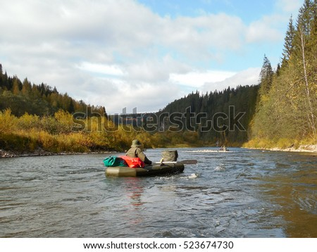 Russian tourists are floating on the river