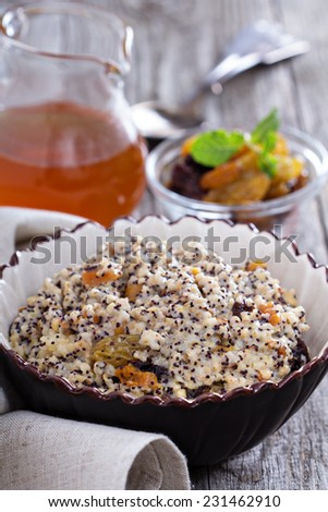 Russian traditional dish Kutia made from wheat with dried fruit - stock photo