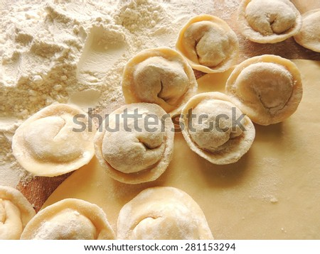 Russian traditional dumplings with meat. Raw homemade pelmeni.